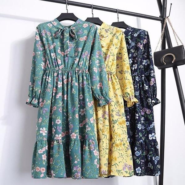 Midi haljina na volane s mašnom 40 modela
