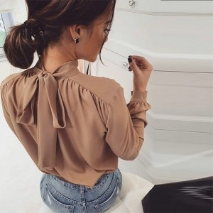 Elegantna bluza s mašnom na leđima