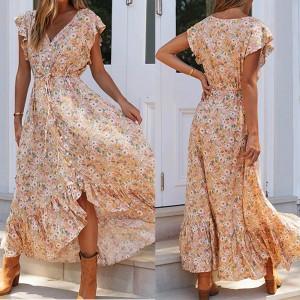 Duga lepršava cvjetna haljina na dugmad veličina M