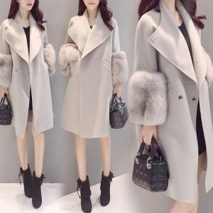 Damski zimski kaput s krznom na rukavima